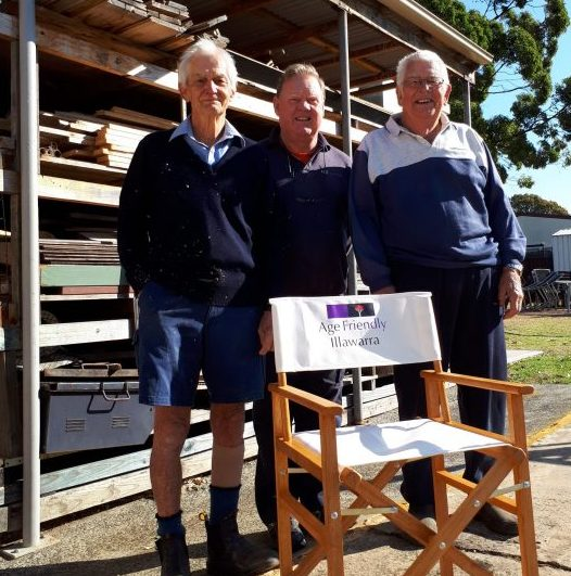 Mens Shed members with chair