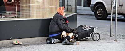 Homeless older woman on street
